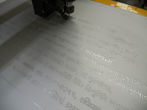 Engraving on anodised aluminium